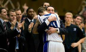 Coach K hugging Grayson